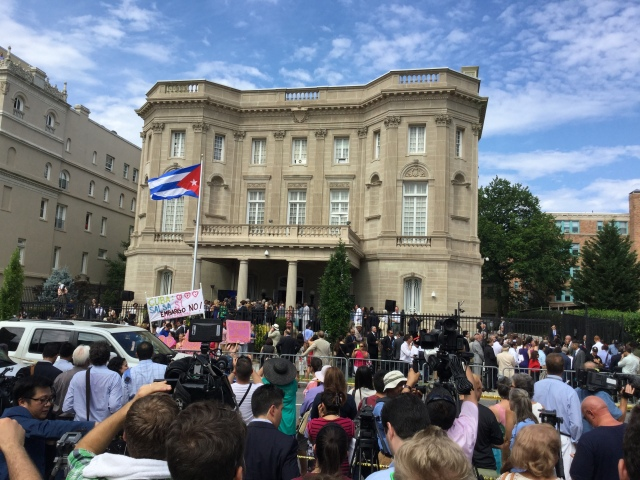 As the Cuban national  anthem plays, the country's flag goes up for the first time over its Washington embassy since 1961. (CNS Photo by Rhina Guidos)