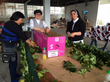 Dominican and Salesian Sisters prepare flowers for Pope Francis' July 7 meeting with educators in Quito. (CNS/Barbara J. Fraser)