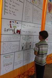 A Paraguayan boy looks at some of the many letters  children wrote to Pope Francis. (CNS/Barbara J. Fraser)
