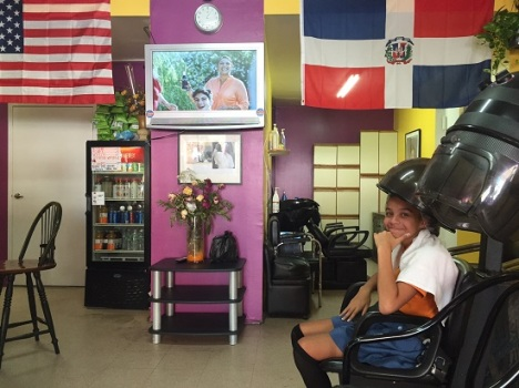Amanda Martinez, 12, sits in a Harlem hair salon across the street from the Catholic school Pope Francis will visit Sept. 25. Her parents are not Catholics, but admire the pope for his message and simplicity. (CNS photo/David Agren)