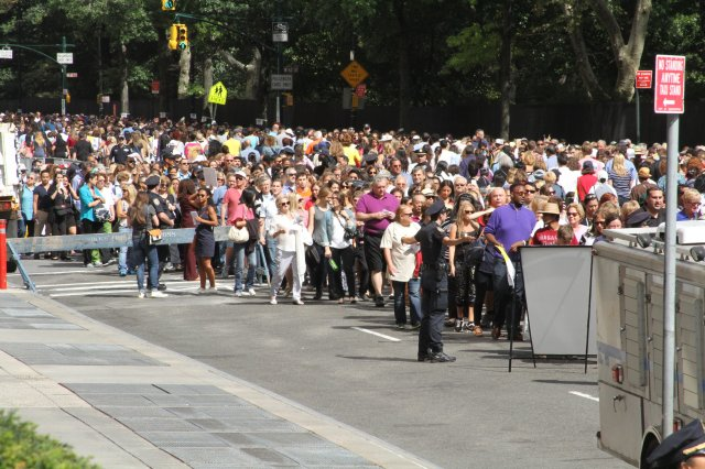 New York City police officers direct ticket-holders for the papal motorcade to the entrance of Central Park on Sept. 25. (CNS photo/Seth Gonzales)