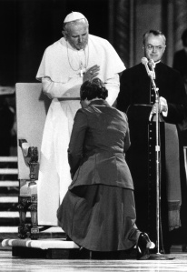 Pope John Paul II blesses Mercy Sister Teresa Kane in 1979. (CNS photo)