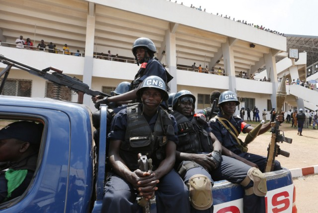 Police patrol at Barthelemy Boganda Stadium in Bangui, Central African Republic,where Pope Francis celebrated Mass Nov. 30. (CNS/Paul Haring)