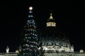Dome of St. Peter's Basilica and the Vatican Christmas tree. (CNS photo/Paul Haring)