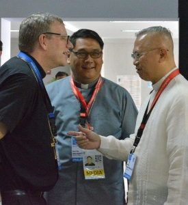Los Angeles Auxiliary Bishop Robert E. Barron chats with Archbishop Jose S. Palma of Cebu, Philippines, right, as Bishop Mylo Hubert Vergary of Pasig, Philippines, looks on before a Jan. 26 news conference at the 51st International Eucharistic Congress in Cebu. (CNS photo/Simone Orendain)