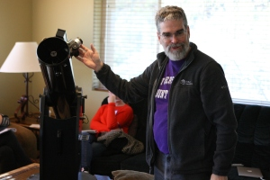 Jesuit Brother Guy Consolmagno, director of the Vatican Observatory, explains the basic workings of a telescope to participants in the Faith and Astronomy Workshop Jan. 12. (CNS/Dennis Sadowski)