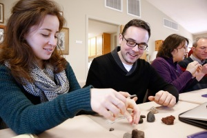 Lauren Bordelon, religion teacher at Mount Carmel Academy in New Orleans, left, and Joseph Varco, science teacher at St. Joseph High School in Metuchen, New Jersey, compare meteorites with earth rocks during the Faith and Astronomy Workshop. (CNS photo/Nancy Wiechec)