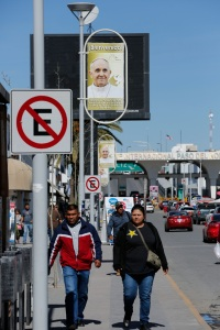 The street leading to the Paso del Norte boring crossing is lined with posters welcoming Pope Francis in Ciudad Juarez, Mexico, Feb. 15. (CNS photo/Nancy Wiechec)