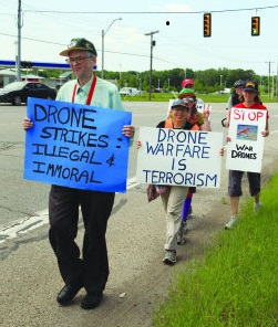 Phil Runkel, left, walks with others Aug. 25 toward Volk Air National Guard Base in Wisconsin to voice concern with U.S. drone policy. (Courtesy Voices for Creative Nonviolence)