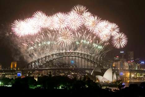 Fireworks explode over the Sydney Harbor Bridge and Opera House during a show to celebrate the New Year Jan. 1, 2014. (CNS photo/Jason Reed, Reuters)