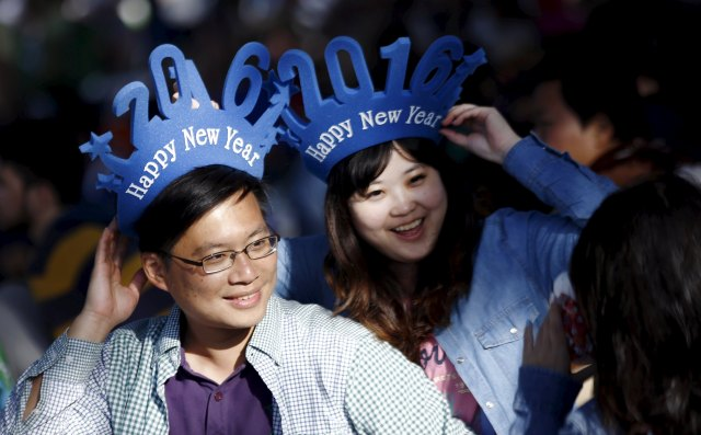 Partygoers wear 2016-themed hats as they wait to ring in the new year at Sydney Harbor Dec. 31. (CNS photo/Jason Reed, Reuters)