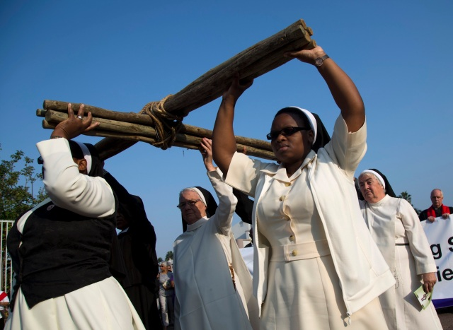 Nuns carry a cross during a silent march during Good Friday celebrations in Durban, South Africa, March 25. (CNS photo/Rogan Ward, Reuters)