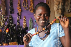 A loan of $100 helped Cynthia in Ghana to stock up on beads and stones for jewelry she makes and sells. (Kiva photo/Juan Barbed)