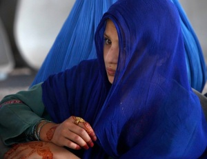 A veiled Afghan woman waits at U.N.-funded center in Pakistan in 2012. (CNS photo/Reuters)