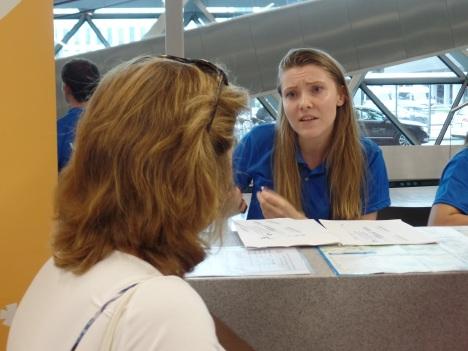 Paulina Tempinska of Krakow, Poland, helps a World Youth Day at John Paul II Airport. (CNS photo/Dennis Sadowski)