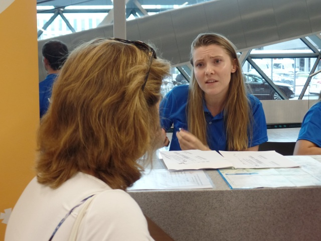 Paulina Tempinska of Krakow, Poland, helps a World Youth Day at John Paul II Airport. (CNS photo/Dennis Sadowski)