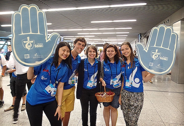 Jacinta Ching of Australia, Augustin Woronoff of Belgium, Jeanne Danson of Switzerland, Lucia Hoppanova and Marianna Burbova, both of Slovakia, were among 70 volunteers greeting World Youth Day pilgrims at John Paul II Airport in Krakow, Poland. (CNS photo/Dennis Sadowski)