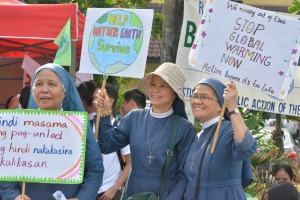 Nuns join climate justice activists at a plaza in Manila, Philippines, Nov. 29, a day ahead of the start of the U.N. climate change conference, known as the COP21 summit, in Paris. (CNS/Simone Orendain).
