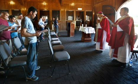 Workers from Ashford Stud farm joined the bishops for Mass. Auxiliary Bishop Jon Manz made a pastoral visit to migrant workers in Kentucky on behalf of the USCCB Sept. 19-22. (Karen Callaway/Catholic New World)