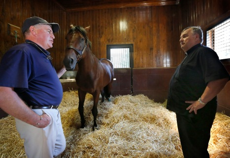 Ashford Stallion Manager Richard Barry introduces American Pharoah to Bishop Manz on Sept. 21. (Karen Callaway/Catholic New World)