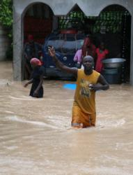 A man wades through floodwaters Oct. 4 in Fonds Parisiens, Haiti. (CNS photo/Orlando Barria, EPA)