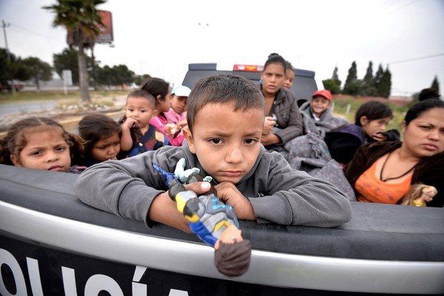 Migrants from Honduras, Guatemala and El Salvador are seen in the back of a Mexican police vehicle in this 2014 file photo. (CNS photo/Miguel Sierra, EPA)