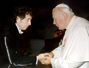Pope John Paul II greets American singer-songwriter Bob Dylan in 1997. (CNS photo/L'Osservatore Romano via EPA)