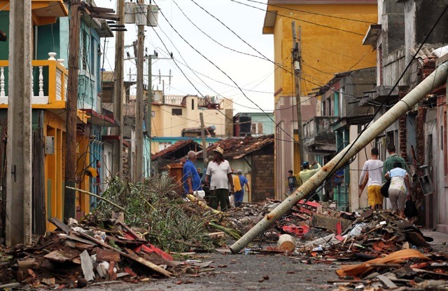 Cubans pick up the pieces following the damage and havoc caused by Hurricane Matthew in Baracoa, Cuba, Oct. 6.