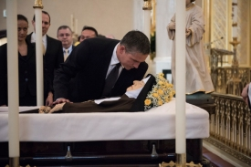 Actor Jim Caviezel pays his respects at the casket of Mother Angelica before her April 1 funeral Mass. (CNS/Jeffrey Bruno, EWTN)