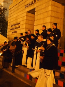 Dominican friars sing carols Dec. 23 on steps outside Smithsonian American Art Museum. (CNS photo/Julie Asher)