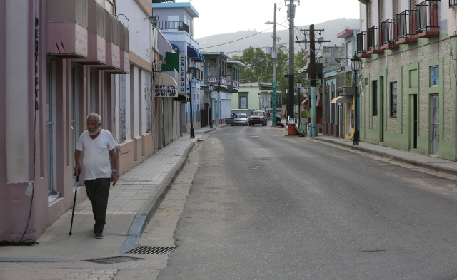 A man walks through an empty street Oct. 21 in Utuato, Puerto Rico. (CNS/Bob Roller)