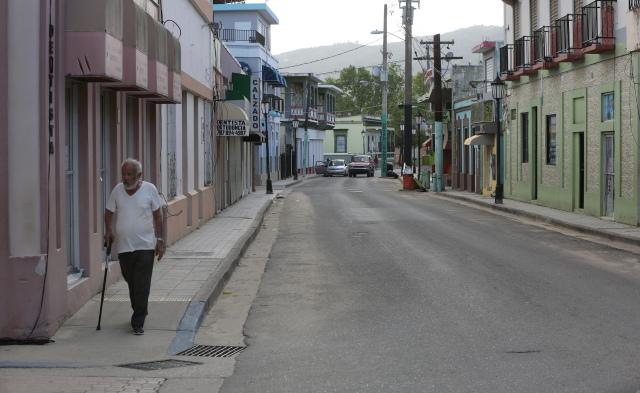 A man walks through an empty street Oct. 21 in Utuato, Puerto Rico. (CNS/Bob Roller)