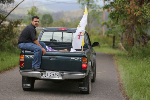 Father Carlos Francis Mendez, pastor of Immaculate Heart of Mary Church in Las Marias, Puerto Rico, delivers aid with parishioners' help to a remote area outside the town Oct. 24. It was the first aid residents of the poor area had received at their homes more than one month after Hurricane Maria devastated the island. (CNS/Bob Roller)