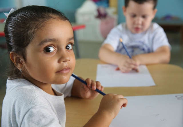 A prekindergarten student looks at the photographer in the classroom at Good Heart of Mary Catholic School in San Juan, Puerto, Rico, Oct. 26. (CNS/Bob Roller)